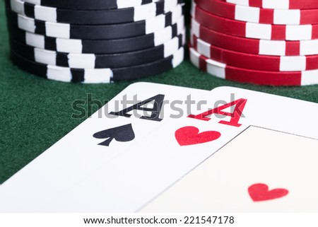 Two aces and casino chips in blackjack game - stock photo