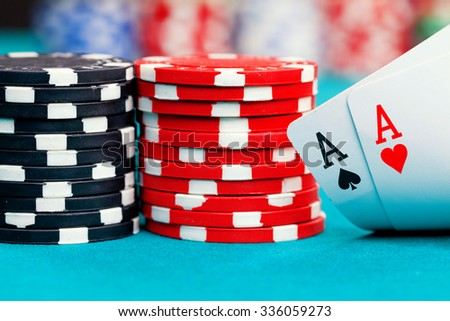 Two aces and gambling chips while playing Texas Holdem