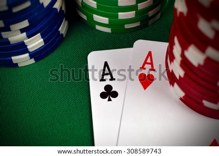 two aces, including spades, hearts, clubs and  poker chips