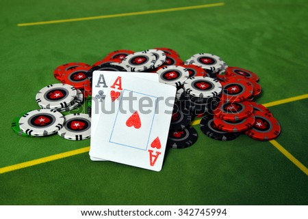 Two aces on casino chips poker - stock photo