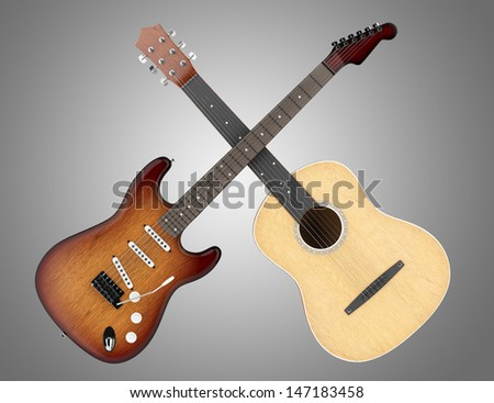 two acoustic and electric guitars isolated on gray background  - stock photo