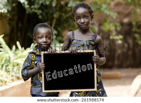 Two African Children Holding Blackboard - Copy Space. Two children posing in the streets of Bamako, Mali. - stock photo