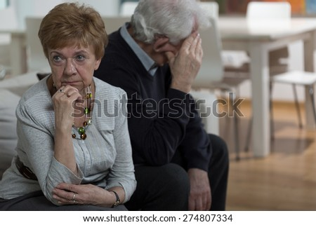 Two aged married people keep quiet after fight - stock photo