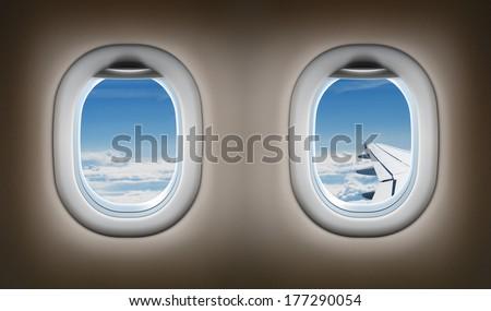 Two airplane windows. Jet interior. - stock photo