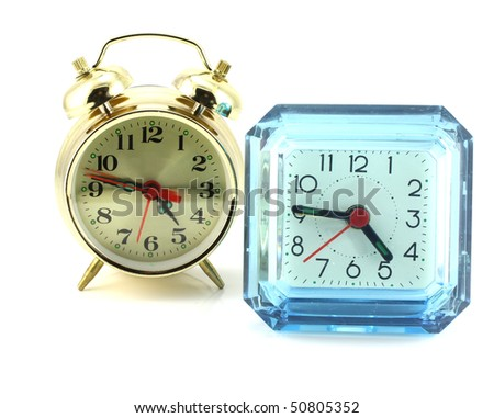 Two alarm clock over white