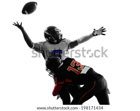 two american football players quarterback sacked fumble in silhouette shadow on white background - stock photo