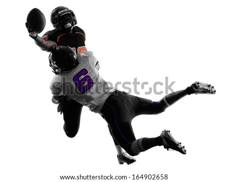 two american football players tackle in silhouette shadow on white background - stock photo
