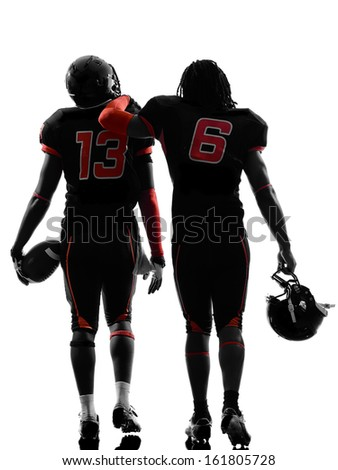 two american football players walking rear view in silhouette shadow on white background - stock photo