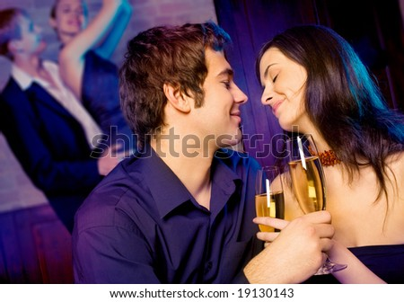 Two amorous couples celebrating together at restaurant - stock photo