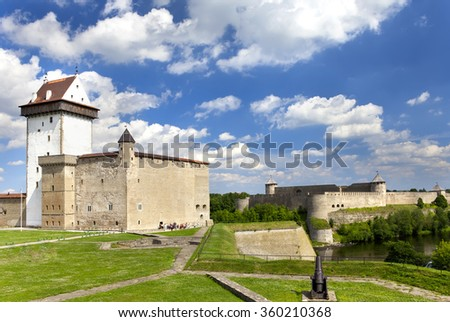 Two ancient fortresses. Narva, Estonia (XIII century) and Ivangorod (XV century) behind the river, Russia - stock photo