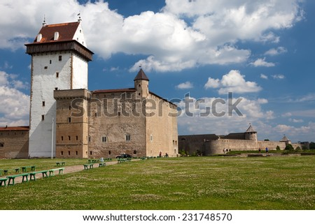 Two ancient fortresses on the parties from the river which is border. Narva, Estonia and Ivangorod behind the river, Russia.  - stock photo