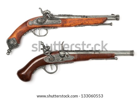 Two ancient pistols on white background