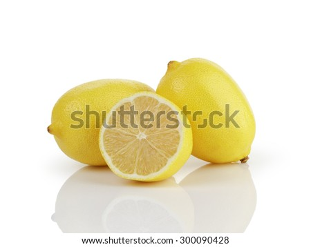 two and a half fresh ripe lemons isolated on white background - stock photo