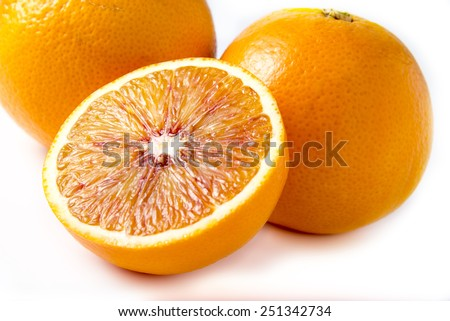Two and half oranges on white background - stock photo