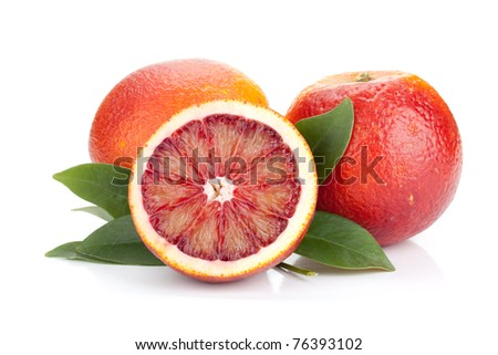Two and half red oranges with leafs. Isolated on white background