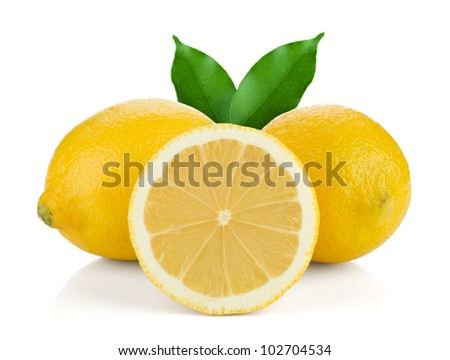 Two and half ripe lemons with green leaves. Isolated on white background