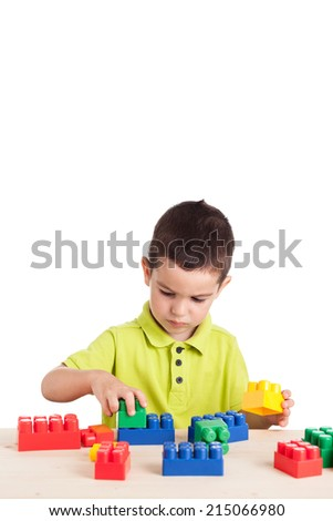 Two and half years old boy playing with colorful blocks. - stock photo
