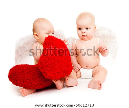 Two angelic baby friends in white diapers holding red heart - stock photo