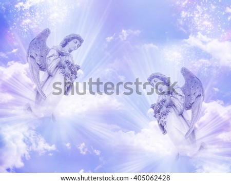 two angels in blue purple tonality - stock photo