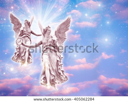 two angels wit rays of light - stock photo