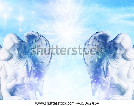 two angels with rays of light and stars - stock photo