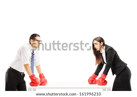 Two angry businesspeople with boxing gloves having an argument isolated on white background - stock photo