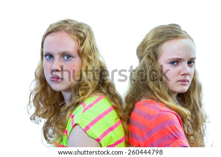 Two angry caucasian teenage girls isolated on white background - stock photo