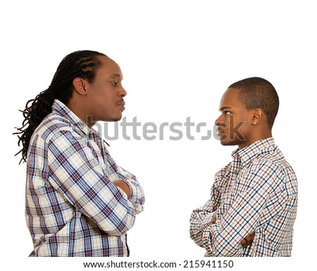 Two angry men looking at each other with hatred, contempt, despise, blaming for mistake isolated white background. Negative human emotions, facial expressions, feelings, body language, bad attitude - stock photo