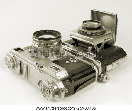 Two antiquarian 35-mm film cameras. - stock photo