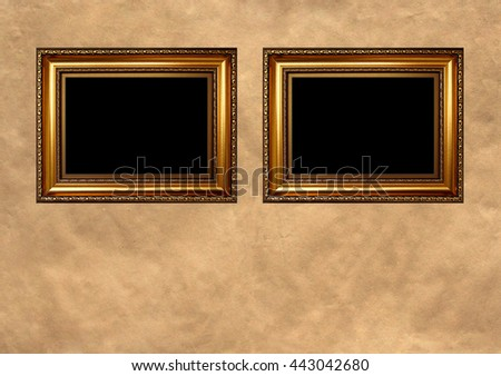 Two antique golden frames with black copy space on vintage background - stock photo