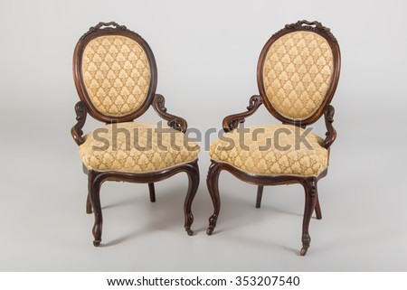 Two antique wooden armchair studio photo with shadows - stock photo