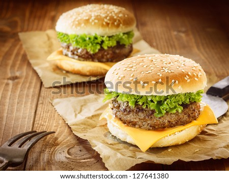 Two appetizing cheeseburger with meat, cheese and salad - stock photo