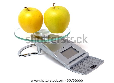 two apples on the digital scale - stock photo