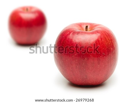Two apples, one in front and one in the background.