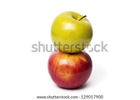 Two apples, Red Delicious and Granny Smith, isolated on white background with clipping path. - stock photo