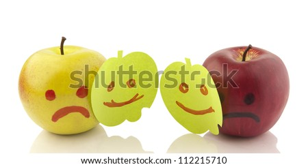 Two apples smiling and crying on white. Concept of hypocrisy to hide feelings of emotion hold your sadness joy couples in romantic relationships and family - stock photo