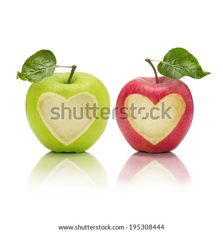 Two apples with heart-shaped parts staring at viewer - stock photo