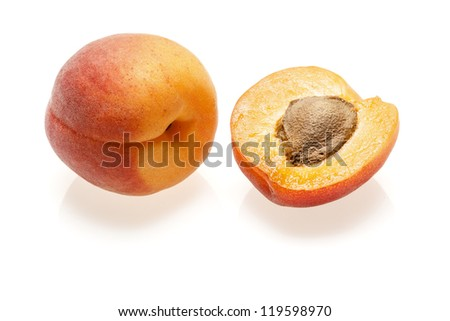 two apricots natural look, close-up on white background - stock photo