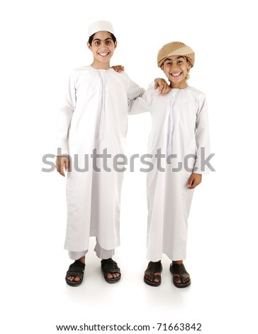 Two Arabic gulf boys in white traditional clothes, isolated on white