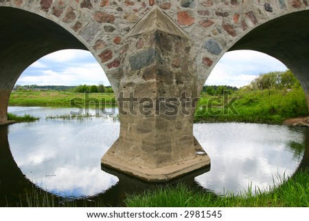 Two arches of a masonry bridge