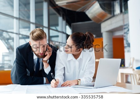 Two architects, business people working on plan at modern office - stock photo