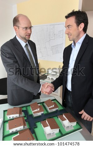 Two architects coming to an agreement - stock photo