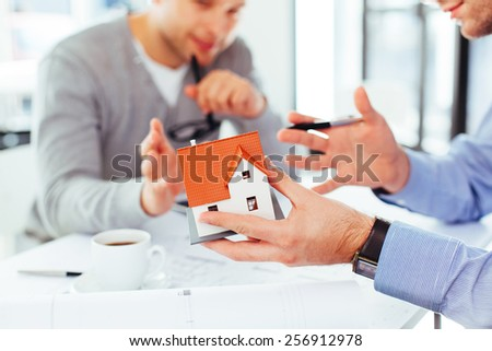 Two architects discussing an architectural problem - stock photo