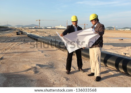 Two architects discussing new project at meeting - stock photo