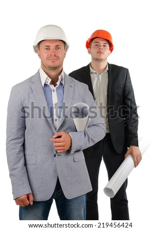Two architects in partnership posing for the camera with the leader or boss in front with a stern expression and a polite junior partner behind doffing his hardhat in greeting, on white - stock photo