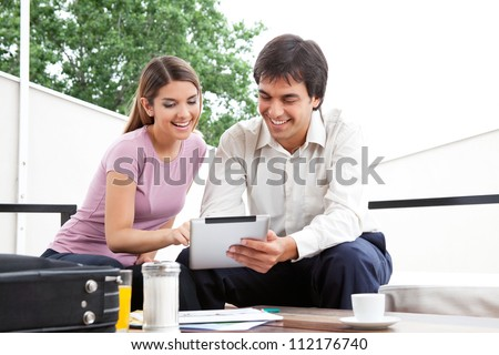 Two architects using digital tablet at work. - stock photo