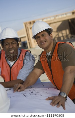 Two architects with a blueprint - stock photo