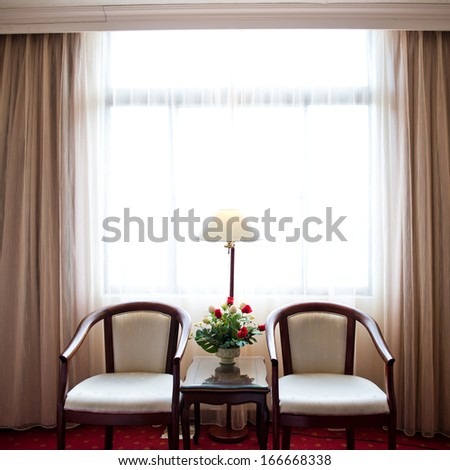 Two armchairs and table in the room for rest. - stock photo