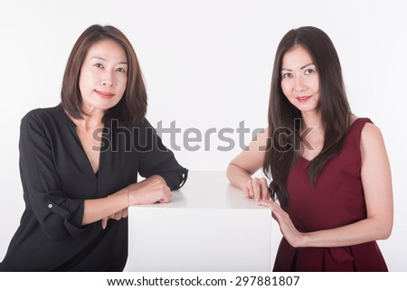 two asian business woman