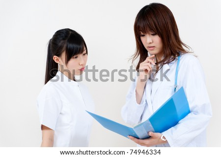 two asian doctors working